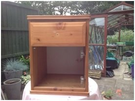 Image of a pine bedside cabinet ready to be upcycled with paint.
