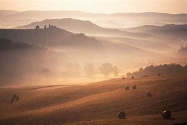An image of a misty autumnal countryside landscape to illustrate warm pastel colours.
