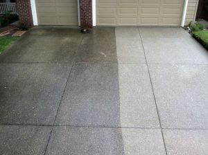 Image of a flagged driveway, half is dirty and half is clean