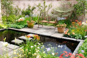 Image of a tranquil garden space with pond and seating