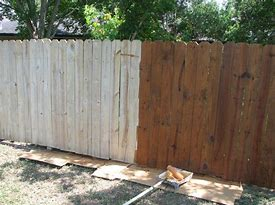 Image of a garden fence half painted