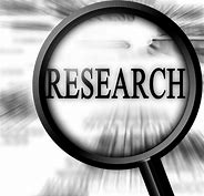 "Image of a magnifying glass with the word ""Research"""