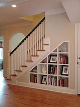 Image of understairs space that has been fitted with compartments for storage