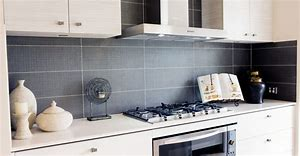 Image of a tiled kitchen splashback
