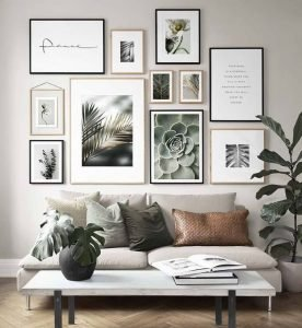 Image of a wall in a living room decorated with a gallery of artwork