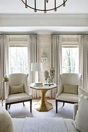 Image of windows in a living room with simple pale curtains