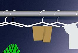 Graphic of a hanging rail with three empty hangers and one hung with a pair of trousers and one with a T Shirt