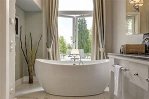 Image a bathroom with freestanding modern bath