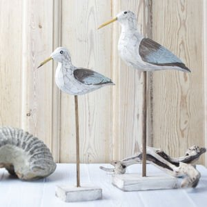 Image of two carved sea birds on stands