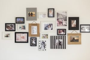Image of a wall hung with family photos