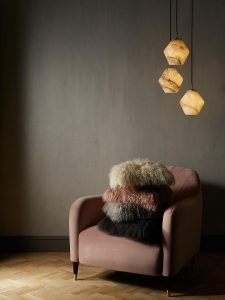 I mage of an image of and armchair piled with mongolian sheepsking cushions