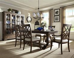Image of a formal dining room with wooden dining table and chairs and dresser