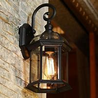 Image of a lantern style outdoor light by a front door