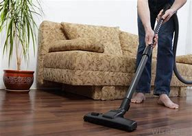 Image of a person vacuuming