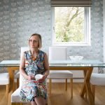 Image of business owner Judith sitting in the dining room of a property she staged