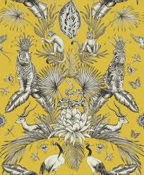 Image of wallpaper. The background is a mustard yellow and the design is an exotic jungle print in grey and white featuring tigers leaves, peacocks and feathers