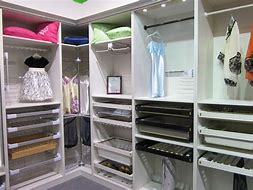 Image of the interior of a wardrobe with shelves and hanging rails.