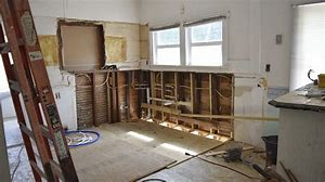 Image of a kitchen being renovated. All the units have been removed and the room is empty