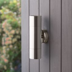 Image of a cylindrical stainless steel light to to side of a front door