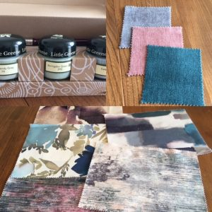 Image of a selection of paint tester pots, fabric samples and upholstery samples on a table