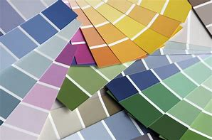 Image of a pile of paint charts of different paint colours fanned out
