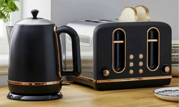 Image of a kettle and a 4 slice toaster on a wooden worktop. The appliances are a charcoal grey with copper trim