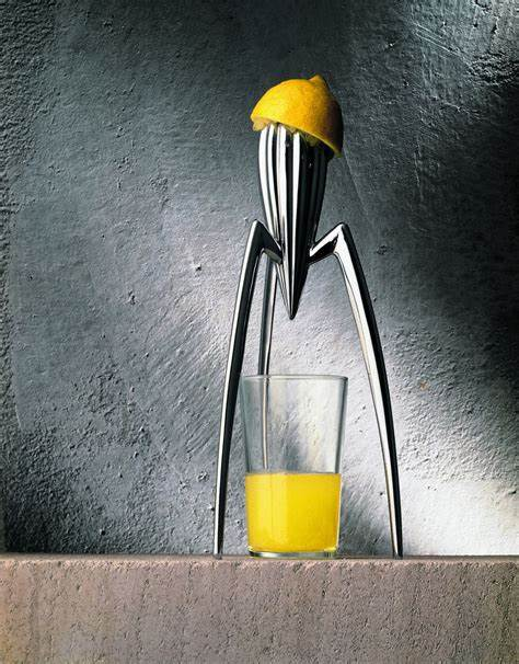 Image of the Alessi JUicer designed by Philippe Starck. The juicer element is on three legs