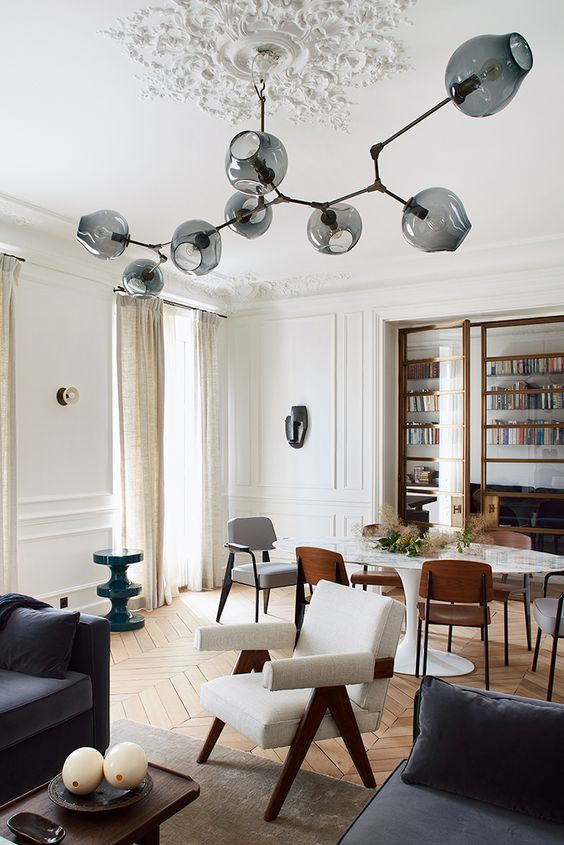 """Image of a modern open plan living room and dining room with statement """"sputnik"""" style branch ceiling light fitting"""