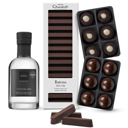 Image of a selection of chocolates and chocolate batons with a miniature bottle of gin